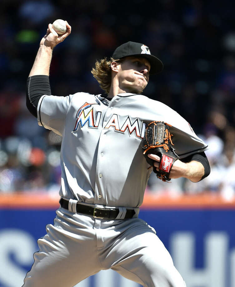 Miami Marlins starter Tom Koehler pitches against the New York Mets in the first inning of a baseball game at Citi Field on Sunday, April 19, 2015, in New York. (AP Photo/Kathy Kmonicek)