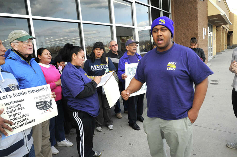David A. Watts District B Council Member and supporter of 32BJ Seiu with protesters Tuesday at the Walmart on Connecticut Avenue for a statewide day of action to highlight inequality in Connecticut. Hour photo/Matthew Vinci