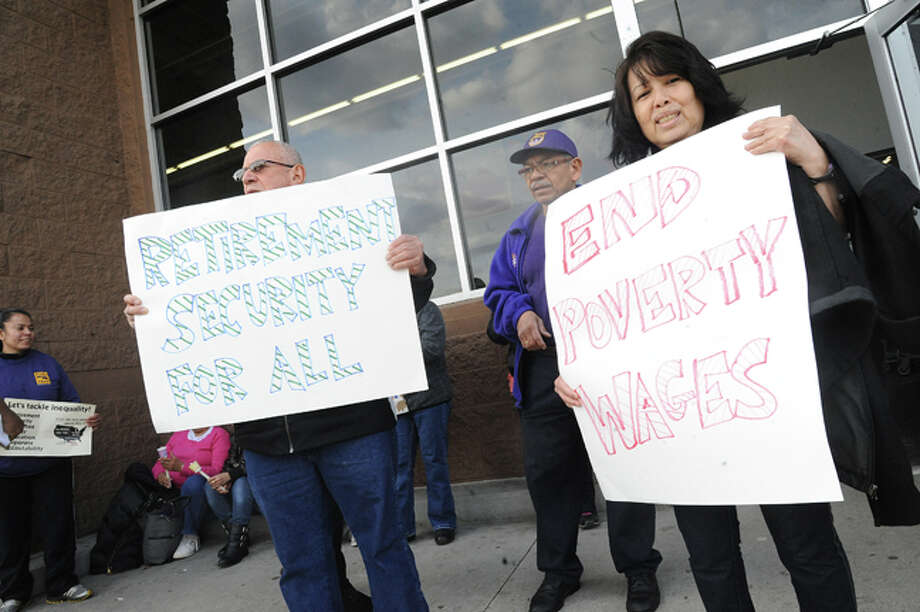 Nelse Rodriguez and Maria Alicia supporters of 32BJ United in Stamford Tuesday at the Walmart on Connecticut Avenue where supporters of a statewide day of action gathered to highlight growing inequality in Connecticut. Hour photo/Matthew Vinci