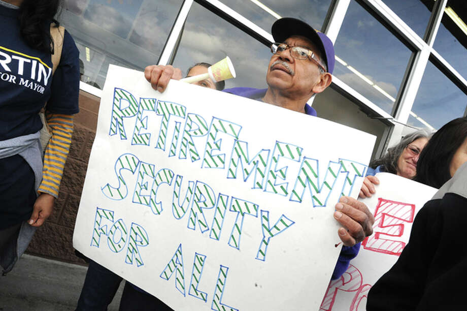 Alcides Caguao with 32BJ United from Stamford Tuesday at the Walmart on Connecticut Avenue where supporters of a statewide day of action gathered to highlight growing inequality in Connecticut. Hour photo/Matthew Vinci