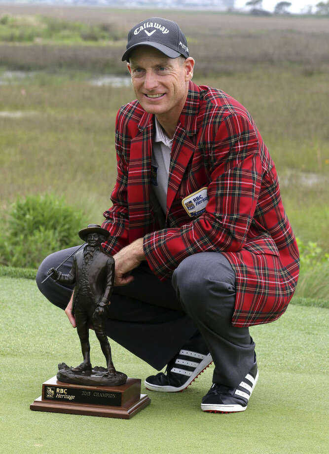 Jim Furyk poses with the trophy after winning a playoff against Kevin Kisner during the RBC Heritage golf tournament in Hilton Head Island, S.C., Sunday, April 19, 2015. (AP Photo/Stephen B. Morton)