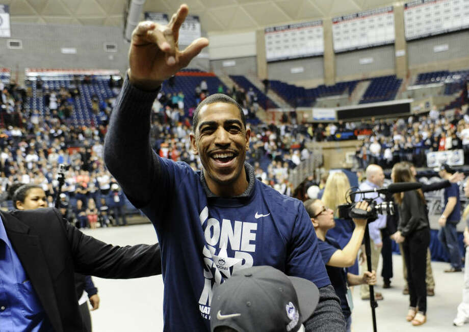 Connecticut head coach Kevin Ollie waves to fans at a pep rally celebrating the program's fourth national championship, Tuesday, April 8, 2014, in Storrs, Conn. (AP Photo/Jessica Hill)