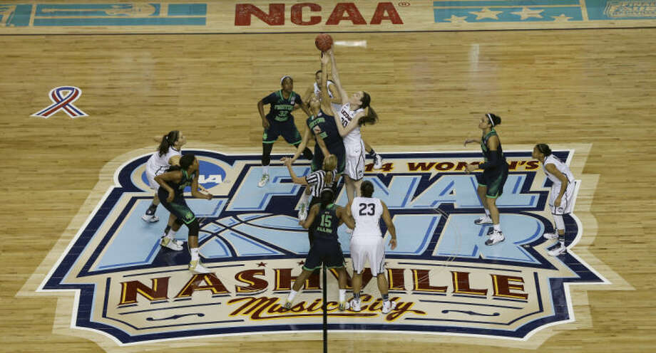 Connecticut forward Breanna Stewart (30) and Notre Dame forward Taya Reimer (12) tip the ball off during the first half of the championship game in the Final Four of the NCAA women's college basketball tournament, Tuesday, April 8, 2014, in Nashville, Tenn. (AP Photo/Mark Humphrey)