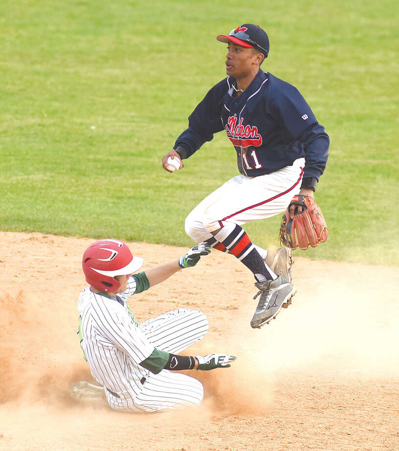 Hour photoJohn Nash - Norwalk second baseman Edwin Owolo, right, leaps out of the way of a sliding Norwalk baserunner Mo Ortiz after a force out in the fifth inning of Sunday's game at Doubleday Field in Cooperstown, N.Y.