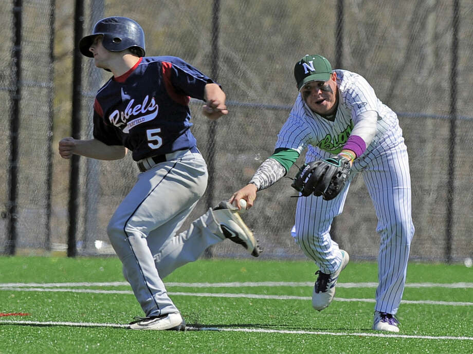 New Fairfield Tyler Hart avoids being tagged out by Norwalk third baseman Eddie O'Hara in a FCIAC boys baseball game in Norwalk on April 16, 2016. New Fairfield defeated Norwalk 11-6.
