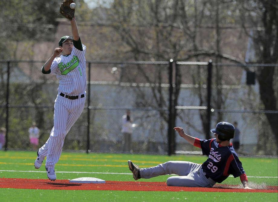 Norwalk second baseman Thomas Benincaso reaches for a high throw as New Fairfield Rudy Sarro slides into second during a FCIAC boys baseball game in Norwalk on April 16, 2016. New Fairfield defeated Norwalk 11-6.