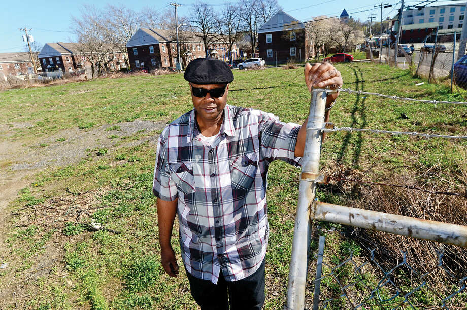 On Wednesday, April 20, 2016, Raymond Dunlap of Washington Village Tenants Association stands in the Day Street lot slotted for the $110 million reconstruction project which recently survived an appeal. The New Britain Superior Court dismissed the Friends of Ryan Park appeal of The Connecticut Department of Energy and Environmental Protection decision allowing the proposed reconstruction of Washington Village to proceed.