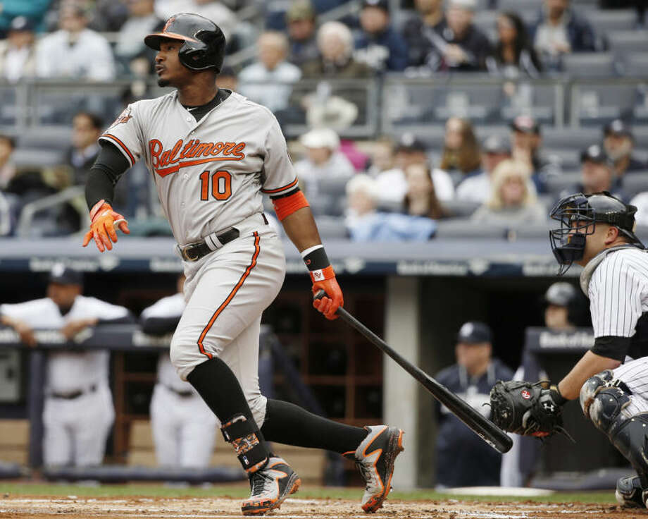 Baltimore Orioles' Adam Jones follows through on a first-inning, two-run home run in a baseball game against the New York Yankees at Yankee Stadium in New York, Tuesday, April 8, 2014. (AP Photo/Kathy Willens)