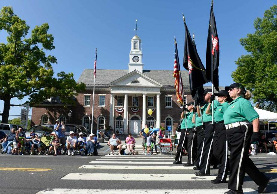 """Members of the Connecticut Alumni Drum & Bugle Corps march past Edmond Town Hall during the 54th Annual Newtown Labor Day Parade in Newtown, Conn. Monday, Sept. 7, 2015. The theme for 2015 was """"Celebrating the fine art of Newtown,"""" and was led by Grand Marshal Ruth Newquist, a Newtown artist. Thousands lined the streets to see a slew of community organizations respresented in the parade, as well as local fire and police departments."""