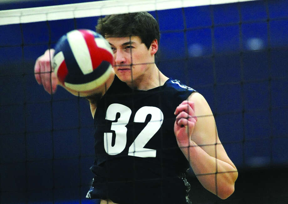 Staples' Christopher DeLaurentis follows through on a spike attempt against Greenwich on Monday. (Hour photo/Matthew Vinci)