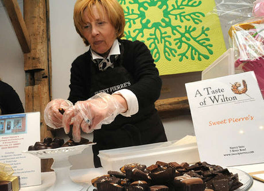 Nancy Saxe owner of Sweet Pierre's Boutique du Chocolat in Wilton at the 2015 Taste of Wilton held at the Wilton Historical Society on Monday. Photo/Matthew Vinci