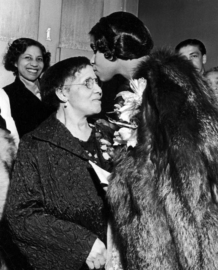 Famous contralto, Marian Anderson bestows a kiss on her mother in front of the Academy of Music's dressing room No. 1 after her concert. (Photo by Alfred Eisenstaedt/The LIFE Picture Collection/Getty Images)