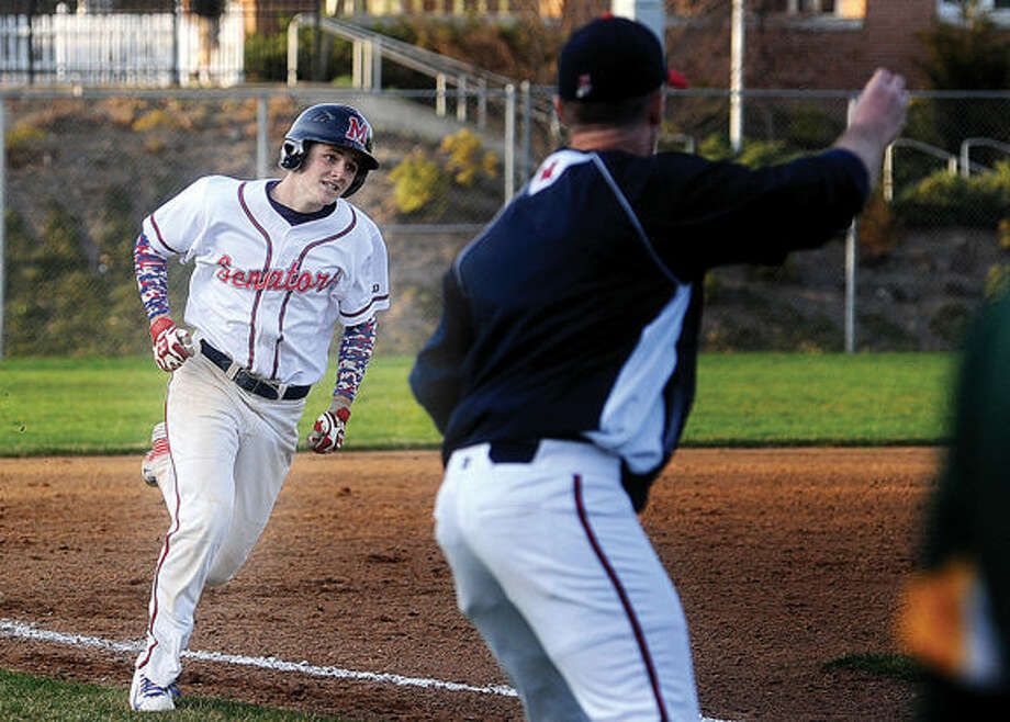 #24 Christopher Winthrop scores against Trinity Catholic in a big inning on Tuesday. Hour photo/Matthew Vinci