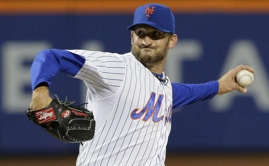 New York Mets pitcher Jonathon Niese delivers against the Atlanta Braves diromg the seventh inning of a baseball game, Tuesday, April 21, 2015, in New York. (AP Photo/Julie Jacobson)
