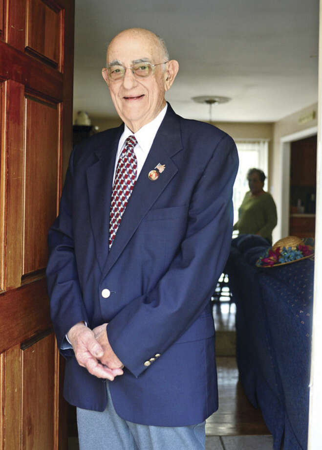 James Ruggiero in his Norwalk home Thursday April 22, 2016. Ruggierio, a U.S. Marine Corps veteran who served during the Korean War, has been chosen by the Norwalk Veterans Memorial Committee, to serve as grand marshal in city's 2016 Memorial Day Parade next month.