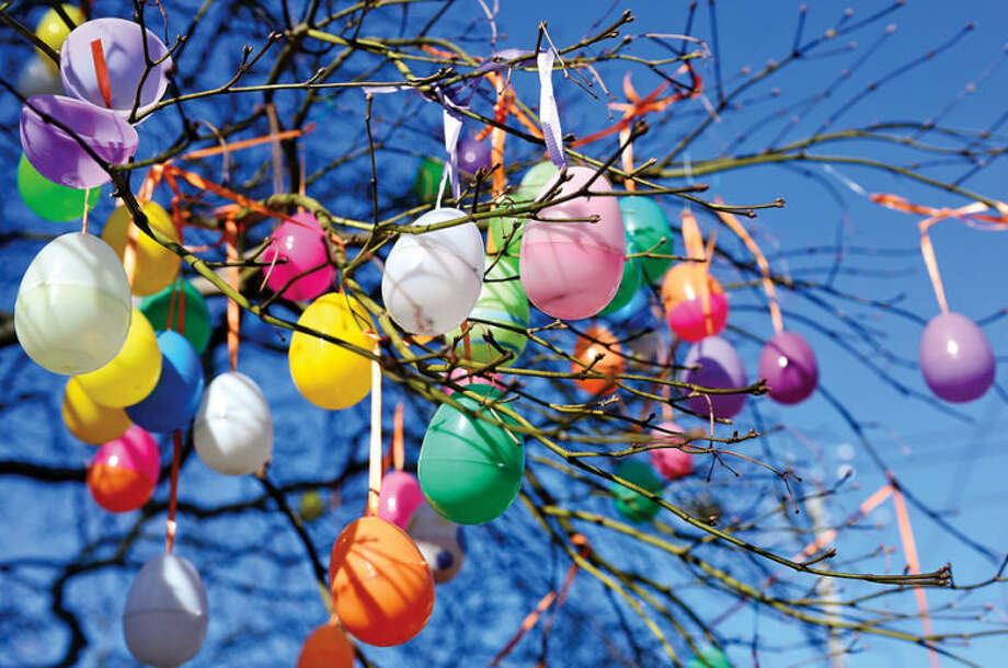 Hour photo / Erik Trautmann Norwalk resident Jalna Jaeger hangs hundreds of Easter eggs on a tree outside her home on East Ave every year.