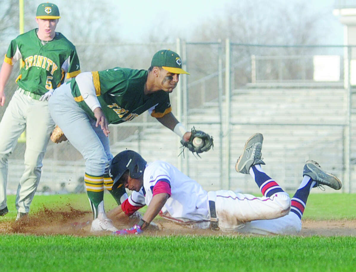 Trinity Catholic's Randy Polonia tag is late as Brien McMahon's Edwin Owolo steals second base safely. (Hour Photo/Matthew Vinci)