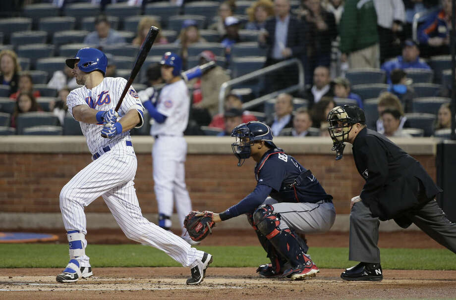 New York Mets catcher Kevin Plawecki follows through on a ground ball against the Atlanta Braves in the second inning of a baseball game, Tuesday, April 21, 2015, in New York. Plawecki was making his major league debut after being called up to replace injured catcher Travis d'Arnaud. (AP Photo/Julie Jacobson)