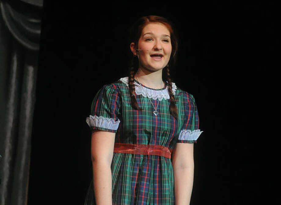 Holly Rybnick as Annie in the dress rehearsal at Norwalk High School on Tuesday. Hour photo/Matthew Vinci