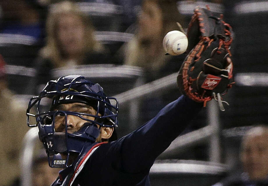 Atlanta Braves catcher Christian Bethancourt can't reach a wide pitch during the sixth inning of the Braves' baseball game against the New York Mets, Tuesday, April 21, 2015, in New York. (AP Photo/Julie Jacobson)