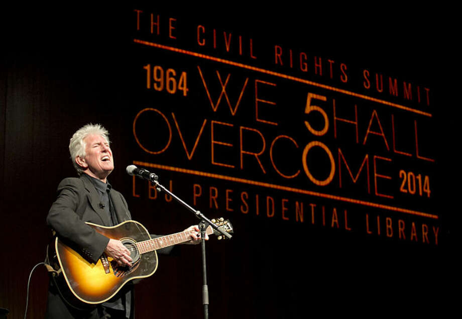 Rock and Roll Hall of Fame singer-songwriter Graham Nash performs during the Civil Rights Summit at the Lyndon B. Johnson Presidential Library, Tuesday, April 8, 2014, in Austin, Texas. (AP Photo/Statesman.com, Jay Janner, Pool)