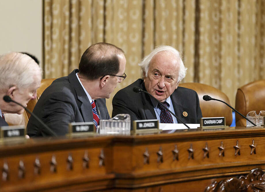 """House Ways and Means Committee Chairman Rep. Dave Camp , R-Mich., and Rep. Sander Levin, D-Mich., the committee's ranking member, right, exchange words on Capitol Hill in Washington, Wednesday, April 9, 2014, during a disagreement over procedure as the panel debates whether IRS official Lois Lerner's refusal to testify to Congress deserves criminal prosecution. After Rep. Levin's insistence that he, the top Democrat, be heard, Chairman Camp told Levin to """"chill out."""" Levin replied that he was """"very chilled out."""" Ways and Means wants the Justice Department to open a criminal probe against Lerner. (AP Photo/J. Scott Applewhite)"""