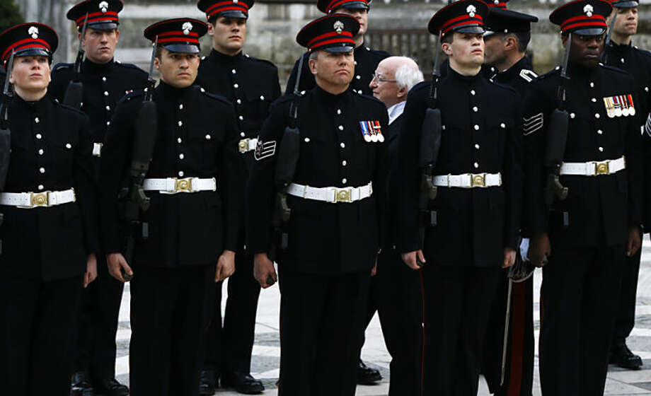 President of Ireland Michael D Higgins, centre right, inspects a Guard of Honour as he arrives to attend a banquet in his honour, at The Guildhall, in London, Wednesday, April 9, 2014. Higgins is on a state visit to Britain, the first ever by an Irish head of state. (AP Photo/Kirsty Wigglesworth)
