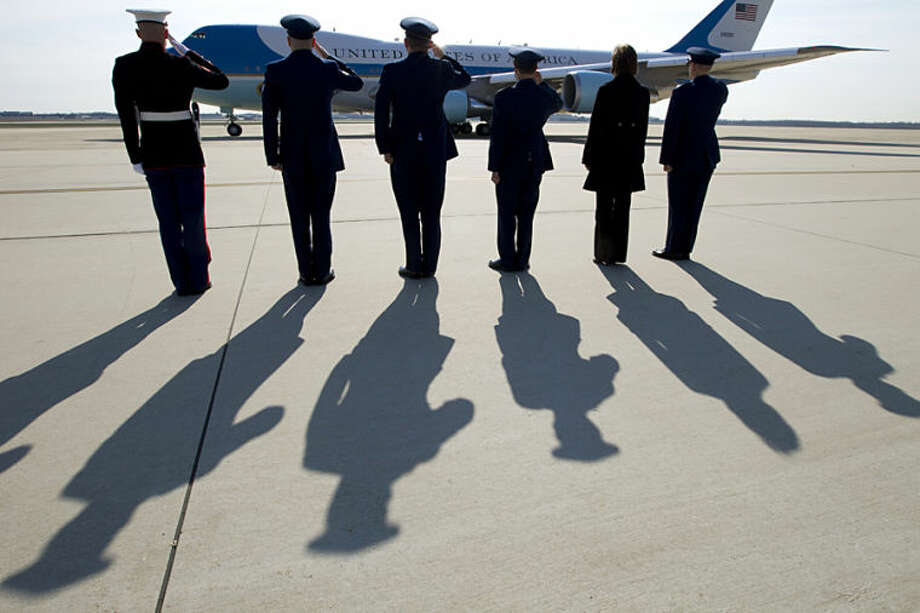 Military members salute as Air Force One, with President Barack Obama and first lady Michelle Obama aboard, departs from Andrews Air Force Base, Md., Wednesday,April 9, 2014, as they travel to Texas to attend Democratic fundraising events and to visit Fort Hood for a ceremony honoring those injured and killed there last week. ( AP Photo/Jose Luis Magana)