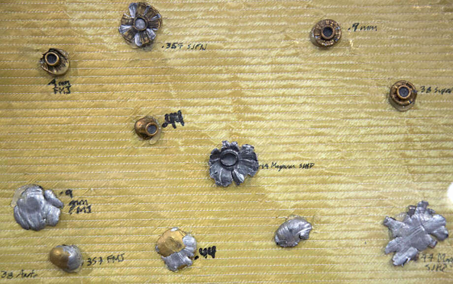 """Different types of bullets are seen after impact on a flak jacket displayed at the """"Expo Seguridad,"""" or Security Expo, in Mexico City, Wednesday, April 9, 2014. The expo offers security related products and services. (AP Photo/Eduardo Verdugo)"""