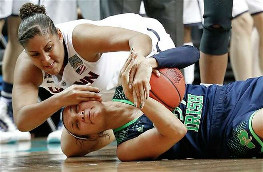 10ThingstoSeeSports - Connecticut forward Kaleena Mosqueda-Lewis, top, and Notre Dame guard Kayla McBride scramble for the ball during the first half of the championship game in the Final Four of the NCAA women's college basketball tournament, Tuesday, April 8, 2014, in Nashville, Tenn. (AP Photo/Mark Humphrey, File) / AP