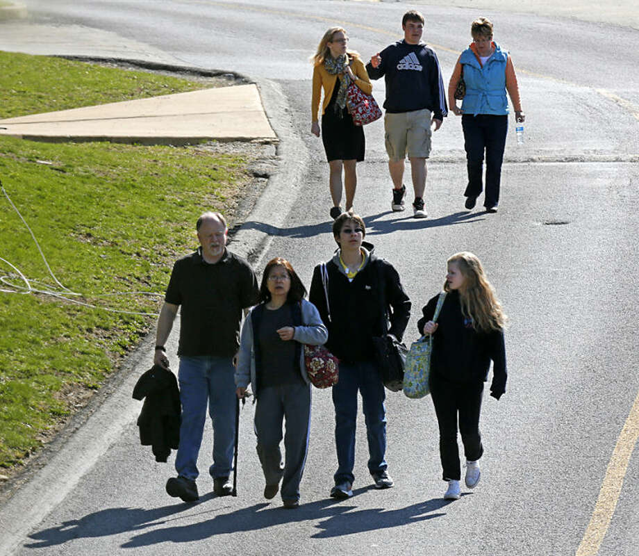 Students are escorted from the campus of the Franklin Regional School District after more then a dozen students were stabbed by a knife wielding suspect at nearby Franklin Regional High School on Wednesday, April 9, 2014, in Murrysville, Pa., near Pittsburgh. The suspect, a male student, was taken into custody and is being questioned. (AP Photo/Gene J. Puskar)