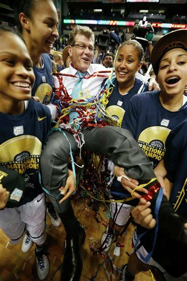 Connecticut players carry Connecticut head coach Geno Auriemma after the second half of the championship game against Notre Dame in the Final Four of the NCAA women's college basketball tournament, Tuesday, April 8, 2014, in Nashville, Tenn. Connecticut won 79-58. (AP Photo/John Bazemore) / AP