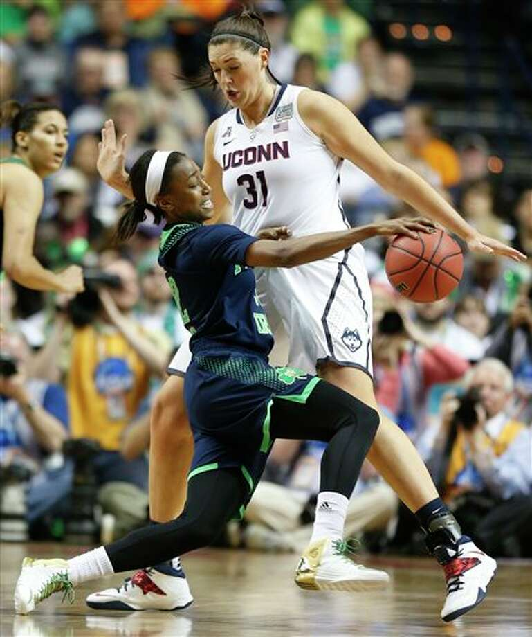 Notre Dame guard Jewell Loyd (32) tries to get through Connecticut center Stefanie Dolson (31) during the second half of the championship game in the Final Four of the NCAA women's college basketball tournament, Tuesday, April 8, 2014, in Nashville, Tenn. (AP Photo/John Bazemore) / AP