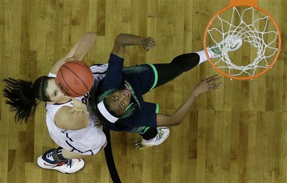 Connecticut center Stefanie Dolson (31) and Notre Dame guard Jewell Loyd (32) vie for a rebound during the second half of the championship game in the Final Four of the NCAA women's college basketball tournament, Tuesday, April 8, 2014, in Nashville, Tenn. (AP Photo/Mark Humphrey) / AP