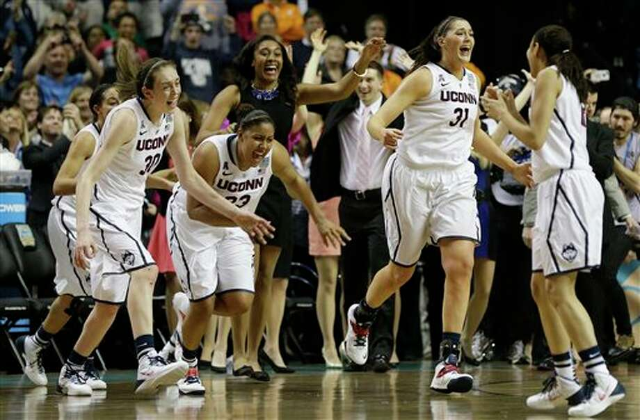 Connecticut players leave the bench after the second half of the championship game against Notre Dame in the Final Four of the NCAA women's college basketball tournament, Tuesday, April 8, 2014, in Nashville, Tenn. Connecticut won 79 -58. (AP Photo/Mark Humphrey) / AP