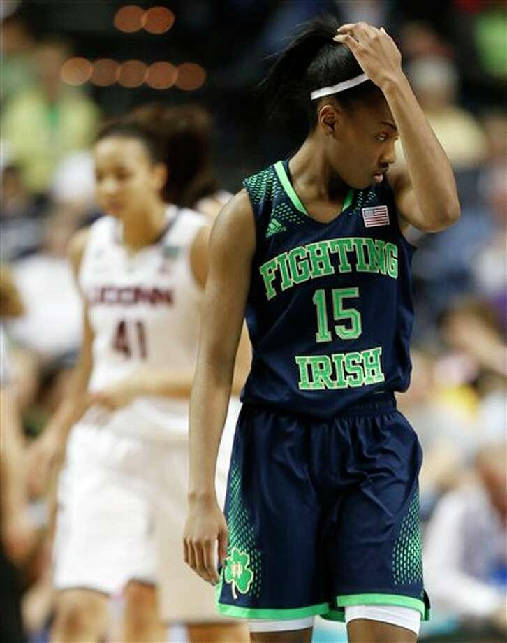 Notre Dame guard Lindsay Allen (15) walks off the court during the second half of the championship game against Connecticut in the Final Four of the NCAA women's college basketball tournament, Tuesday, April 8, 2014, in Nashville, Tenn. (AP Photo/John Bazemore) / AP
