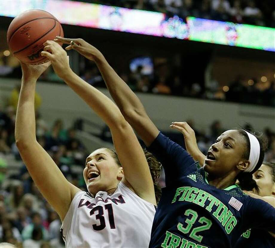 Connecticut center Stefanie Dolson (31) rebounds a ball against Notre Dame guard Jewell Loyd (32) during the second half of the championship game in the Final Four of the NCAA women's college basketball tournament, Tuesday, April 8, 2014, in Nashville, Tenn. (AP Photo/Mark Humphrey) / AP