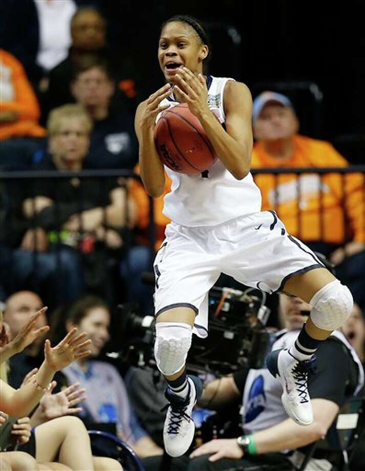 Connecticut guard Moriah Jefferson (4) flies off court against Notre Dame during the second half of the championship game in the Final Four of the NCAA women's college basketball tournament, Tuesday, April 8, 2014, in Nashville, Tenn. (AP Photo/Mark Humphrey) / AP