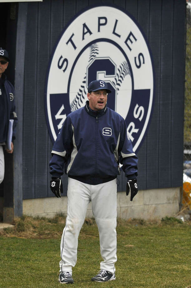Staples head coach Jack McFarland watches the game in the third base coach position during the Wreckers' baseball game against Newtown at Staples High School in Westport, Conn., on Wednesday, April 8, 2015. Staples won, 5-4.