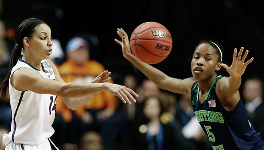 Connecticut guard Bria Hartley (14) passes the ball as Notre Dame guard Lindsay Allen (15) looks on during the second half of the championship game in the Final Four of the NCAA women's college basketball tournament, Tuesday, April 8, 2014, in Nashville, Tenn. (AP Photo/Mark Humphrey) / AP