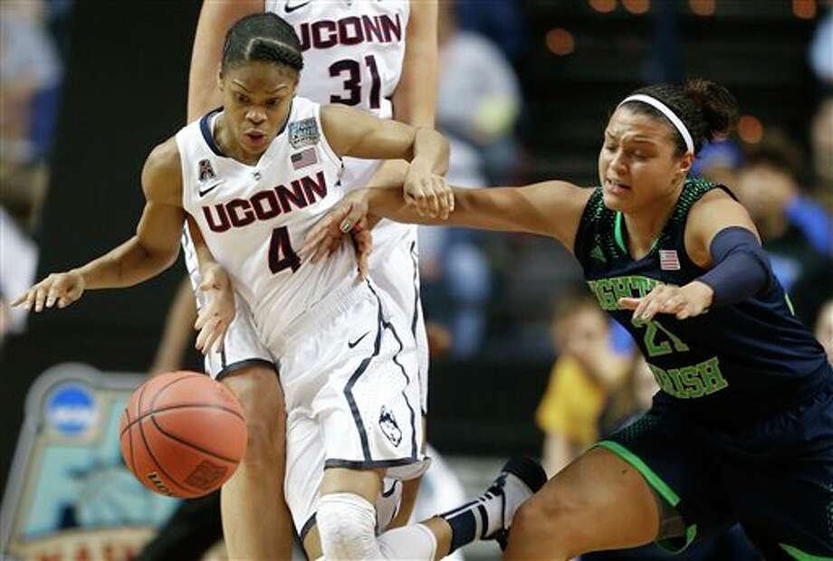 Notre Dame guard Kayla McBride (21) and Connecticut guard Moriah Jefferson (4) vie for a loose ball during the second half of the championship game in the Final Four of the NCAA women's college basketball tournament, Tuesday, April 8, 2014, in Nashville, Tenn. (AP Photo/John Bazemore) / AP