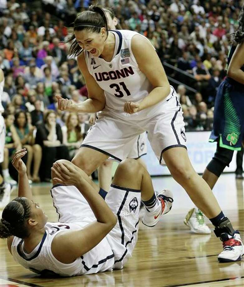 Connecticut's Stefanie Dolson (31) celebrates Kaleena Mosqueda-Lewis's basket against Notre Dame during the second half of the championship game in the Final Four of the NCAA women's college basketball tournament, Tuesday, April 8, 2014, in Nashville, Tenn. (AP Photo/Mark Humphrey) / AP