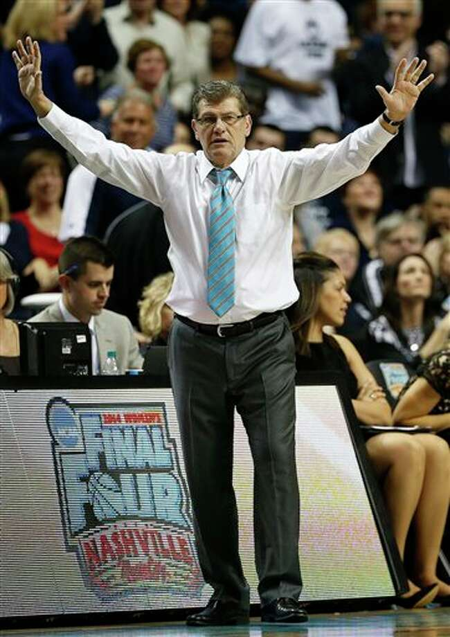 Connecticut head coach Geno Auriemma calls a play against Notre Dame during the second half of the championship game in the Final Four of the NCAA women's college basketball tournament, Tuesday, April 8, 2014, in Nashville, Tenn. (AP Photo/Mark Humphrey) / AP
