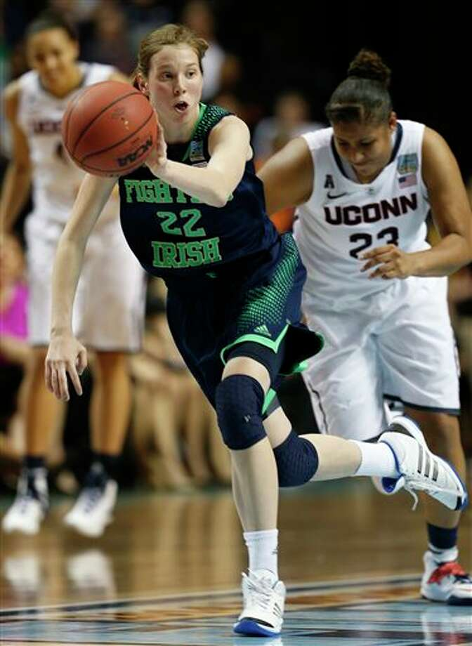 Notre Dame guard Madison Cable (22) brings the ball up court against Connecticut during the second half of the championship game in the Final Four of the NCAA women's college basketball tournament, Tuesday, April 8, 2014, in Nashville, Tenn. (AP Photo/Mark Humphrey) / AP