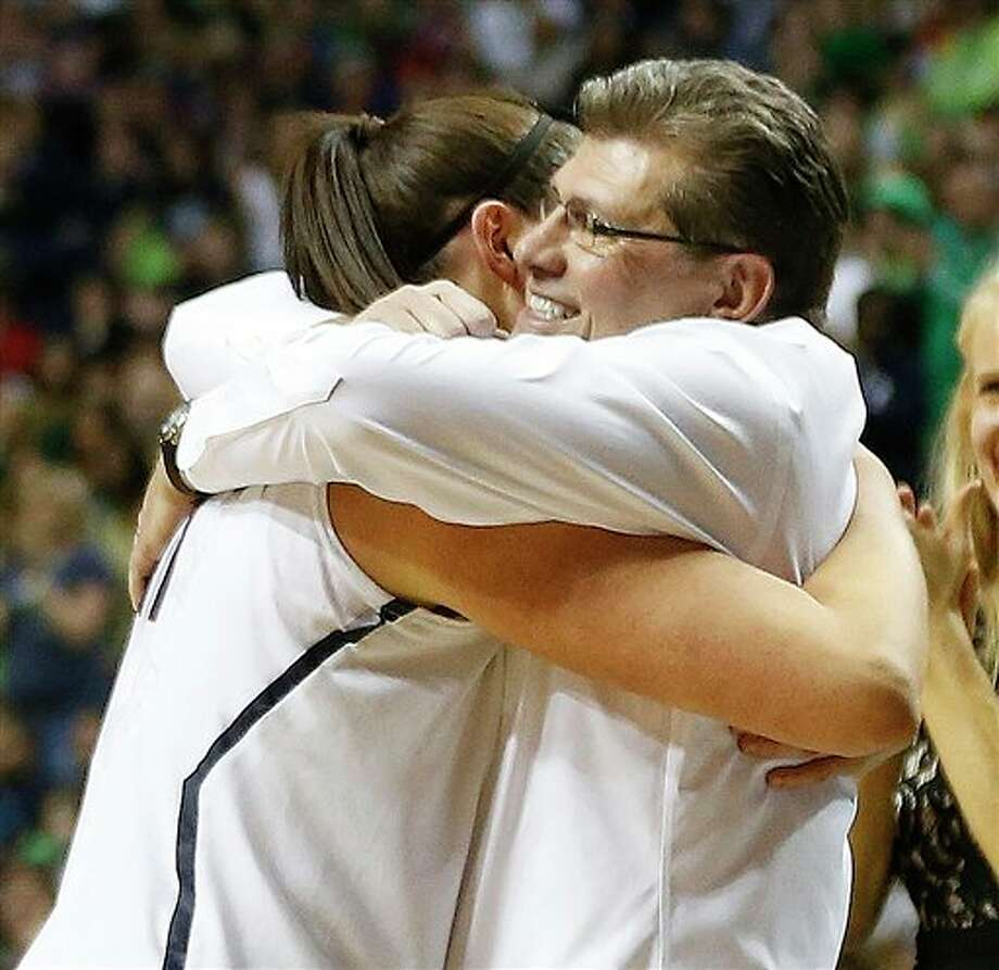 Connecticut center Stefanie Dolson (31) embraces Connecticut head coach Geno Auriemma during the second half of the championship game against Notre Dame in the Final Four of the NCAA women's college basketball tournament, Tuesday, April 8, 2014, in Nashville, Tenn. Connecticut won 79-58. (AP Photo/John Bazemore) / AP