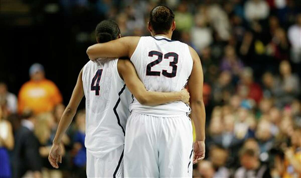 Connecticut's Moriah Jefferson (4) and Kaleena Mosqueda-Lewis (23) walks off the court against Notre Dame during the second half of the championship game in the Final Four of the NCAA women's college basketball tournament, Tuesday, April 8, 2014, in Nashville, Tenn. (AP Photo/Mark Humphrey)