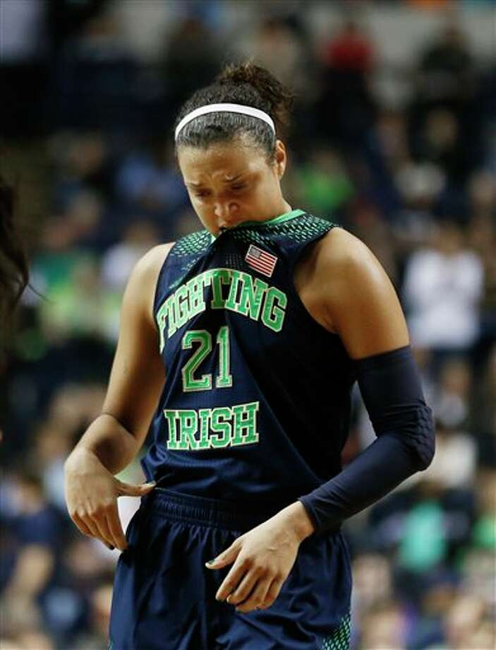 Notre Dame guard Kayla McBride (21) walks down court against Connecticut during the second half of the championship game in the Final Four of the NCAA women's college basketball tournament, Tuesday, April 8, 2014, in Nashville, Tenn. Connecticut won 79-58. (AP Photo/John Bazemore) / AP