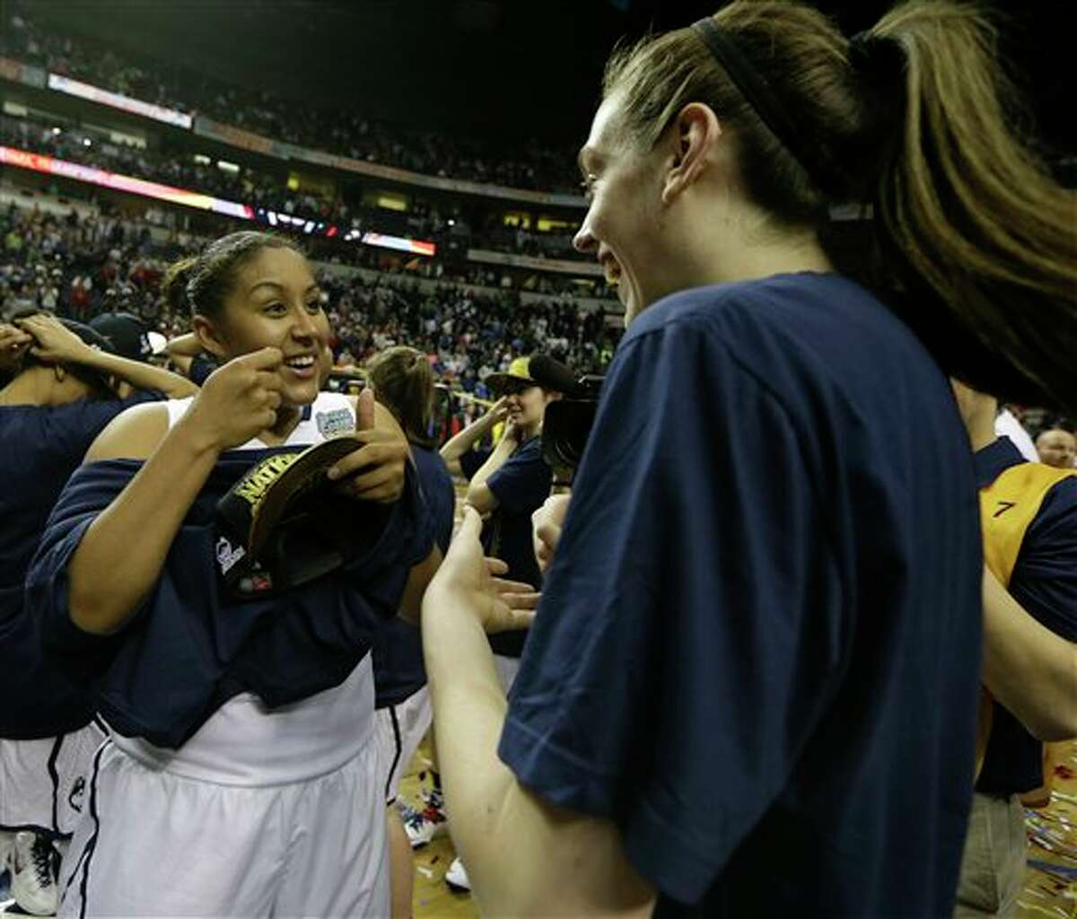 Connecticut forward Kaleena Mosqueda-Lewis (23) Connecticut forward Breanna Stewart (30) after the second half of the championship game in the Final Four of the NCAA women's college basketball tournament, Tuesday, April 8, 2014, in Nashville, Tenn. (AP Photo/Mark Humphrey)