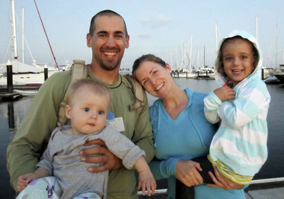 "FILE - This undated file image provided by Sariah English shows Eric and Charlotte Kaufman with their daughters, Lyra, 1, and Cora, 3. None of the three federal agencies that helped rescue the ill 1-year-old and her family from their broken down sailboat about 900 miles off Mexico's Pacific coast plan to seek reimbursement for the cost of the operation. Officials from the Navy, Coast Guard and California Air National Guard said Tuesday, April 8, 2014, they don't charge for search-and-rescue missions. ""We don't want people in trouble at sea to hesitate to call for help for fear they'll be charged for assistance,"" said Lt. Anna Dixon of the 11th Coast Guard District, which oversaw the operation but did not send vessels or aircraft to the stranded sailboat. She said that helping at sea is a time-honored tradition and a requirement of international maritime convention. The Navy warship that picked up the family on Sunday is expected to reach San Diego on Wednesday. (AP Photo/Sariah English. File)"