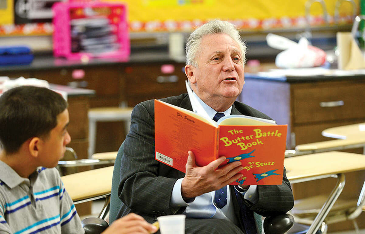 """Hour photo / Erik Trautmann Norwalk Mayor Harry Rilling reads theThe Butter Battle Book tyo students as West Rocks Middle School holds a program titled """"Safe, Peaceful and Non-Violent West Rocks Community"""" Friday morning. The program is a part of Positive Behavior Intervention Supports (PBIS), a statewide program to encourage positive behavior in students."""